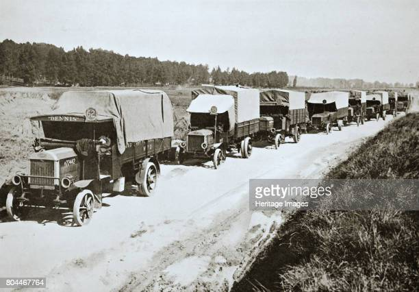 A long white line A common sight in France' World War I 1916 A line of British army trucks during the Somme campaign Artist Unknown