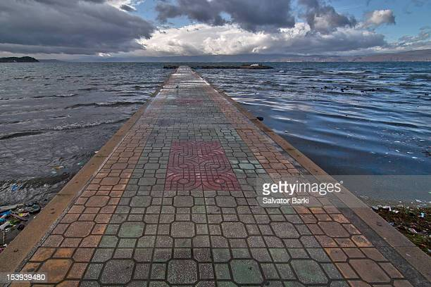 A long wooden jetty on Lake Ohrid with Clouds, Lake Ohrid, Macedonia FMRI