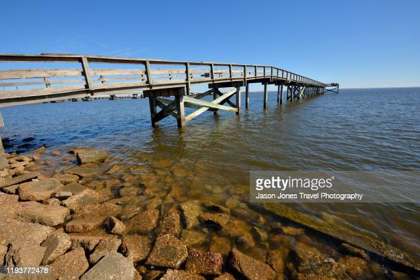 long wooden jetty - gulf coast states stock pictures, royalty-free photos & images