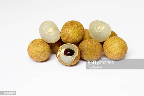 Longan fruit against white background