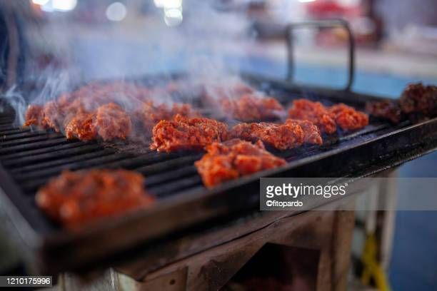 longaniza sausage being cooked in a grill al in close up - mexican picnic stock pictures, royalty-free photos & images