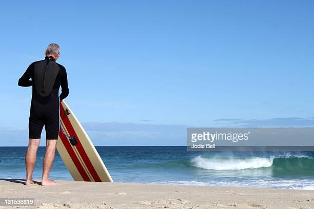 Longboard surfer getting ready