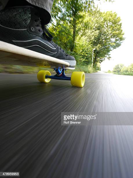 Longboarder skateboarder are exercising