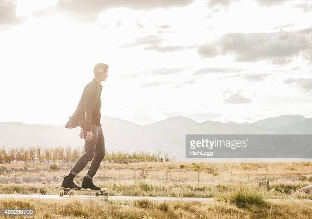 longboarding in the evening - rich_legg stock photos and pictures