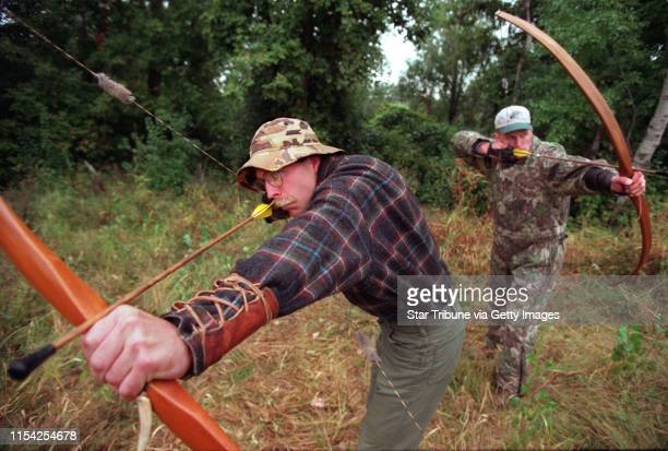 Longbow hunting Bob Usgaard left and Matt Holland practice their draws of the longbow during a practice session NOTE THIS WAS NOT SHOT IN CARLOS...
