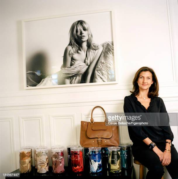 Longchamp fashion designer Sophie Delafontaine is photographed with a photo of her muse, model Kate Moss for Madame Figaro on October 21, 2011 in...