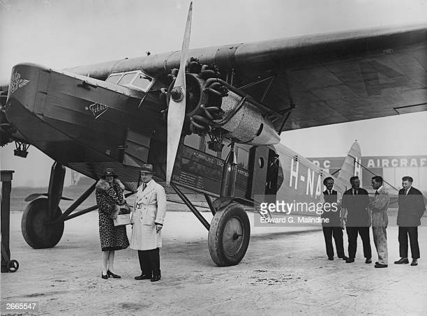 Longdistance aviator Lady Heath the first woman to be engaged as a pilot on a passenger airservice standing in front of a Dutch airline KLM Fokker...
