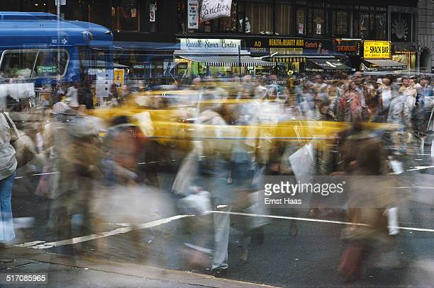 A longexposure image of a busy street crossing in New York City May 1978
