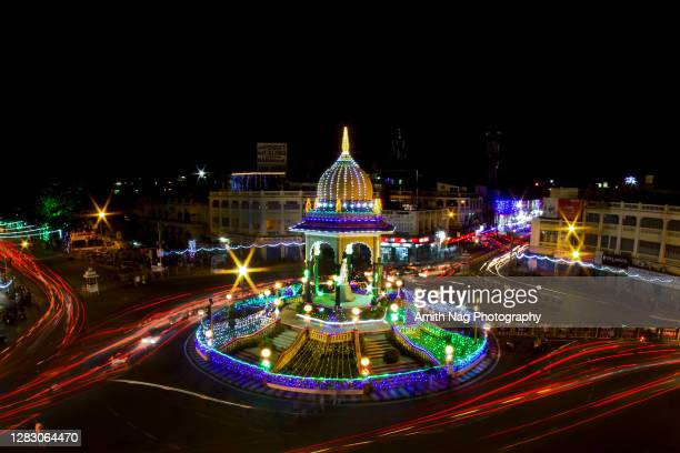 a long-exposure of traffic trails around the famous kr circle - karnataka stock pictures, royalty-free photos & images