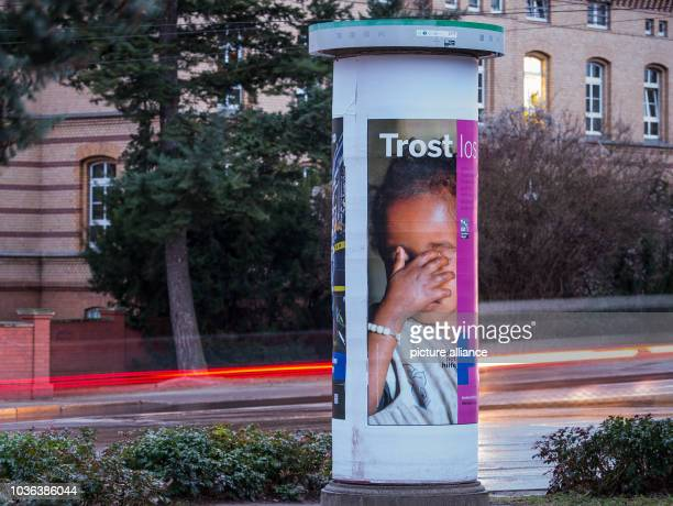 A longexposure shot shows light trails left by cars next to an advertising column in Frankfurt an der Oder Germany 08 February 2016 Although 200...