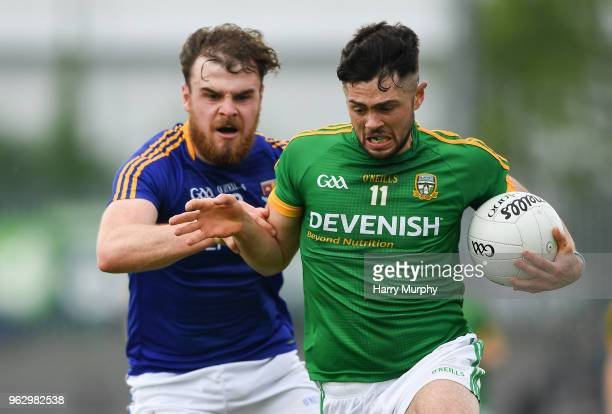 Longford Ireland 27 May 2018 Ben Brennan of Meath in action against Conor Berry of Longford during the Leinster GAA Football Senior Championship...