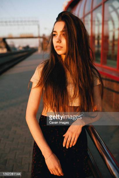 long-haired woman stands at the train station - bending over in skirt stock pictures, royalty-free photos & images