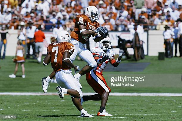 Longhorn safety Dakarai Pearson lines up to intercept the pass intended for Terrance Davis-Bryant of the Oklahoma State Cowboys during the NCAA...