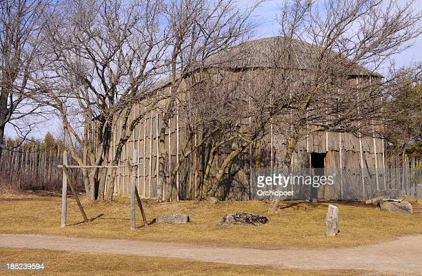 longhouse in first nations village - first nations stock pictures, royalty-free photos & images