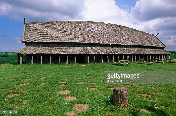 longhouse in stave style at viking ring fortress (960), trelleborg, west zealand, denmark, europe - longhouse stock photos and pictures