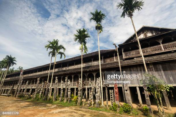 longhouse of the borneo dayak community - longhouse stock photos and pictures