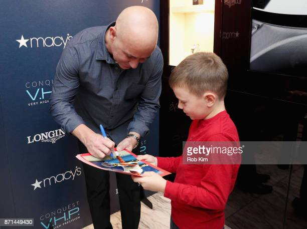 Longines Ambassador of Elegance Andre Agassi welcomes guests at the Longines shopinshop inside Macys Herald Square for the US launch of the Conquest...