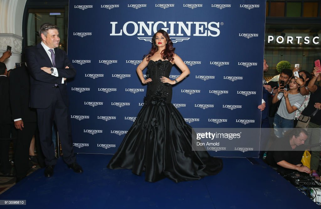 Longines Vice-President Juan-Carlos Capelli looks on as Aishwarya Rai Bachchan poses during the official Longines Australian boutique launch on February 3, 2018 in Sydney, Australia.