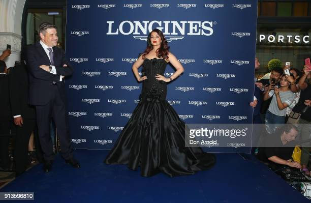 Longines VicePresident JuanCarlos Capelli looks on as Aishwarya Rai Bachchan poses during the official Longines Australian boutique launch on...