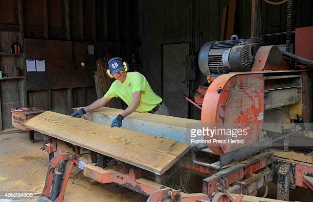 Longleaf lumber mill in Berwick repurposes reclaimed lumber and wood Sawyer Dan Laprise cuts boards from reclaimed beams