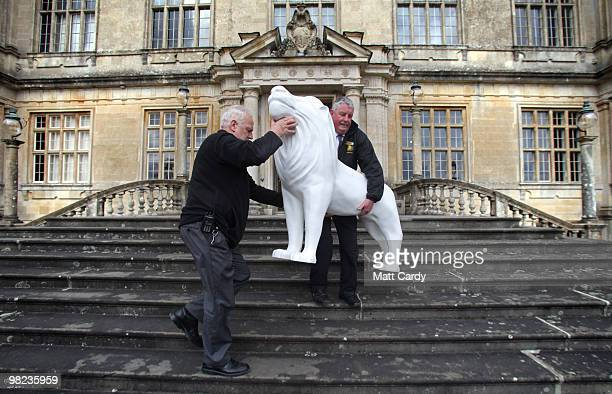 Longleat staff Mike Matthews and Steve Savage deliver a life size lion to Lord Bath which has been given to him by the Lions of Bath public art...