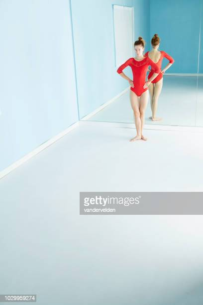 long-legged dancer resting - full length mirror stock photos and pictures