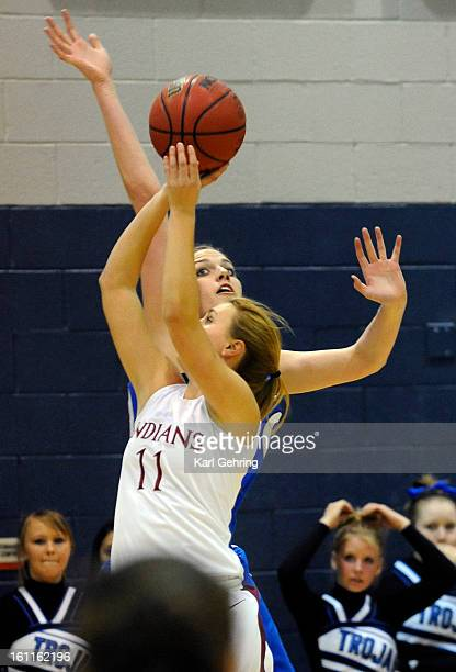 Longmont center Megan Carpenter goes up to swat away a shot by Cheyenne Mountain guard Vivian Snider in the first half Saturday night The Longmont...