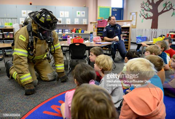 Longmont firefighter Jerry Wisne demonstrates to Alexis Vorhaus' kindergarten class how to stay low in a smokefilled room Wednesday morning Oct 09...