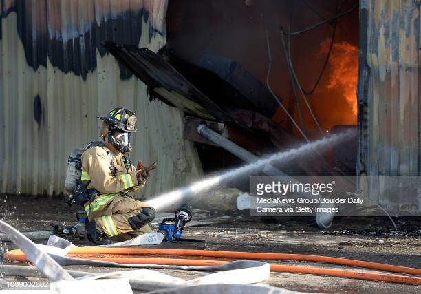Longmont firefighters work to put out a structure fire at 110 Bowen St in Longmont on Wednesday Feb 26 The fire was allegedly caused by a vehicle...