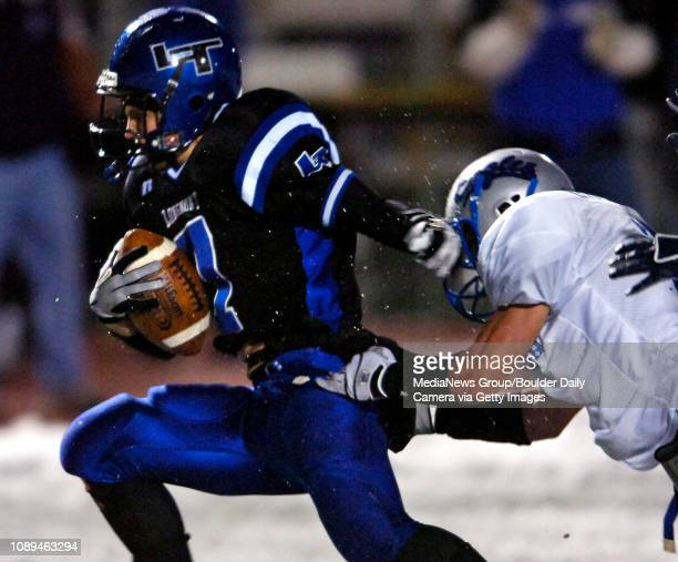 Longmont running back Micah Current breaks the tackle of a Broomfield defender to score the Trojans' first touchdown in the first half at...