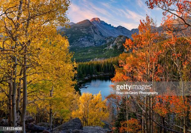 longs peak bear lake autumn - front range mountain range stock pictures, royalty-free photos & images