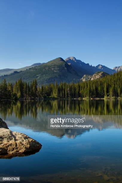 longs peak reflects in bear lake on a summer day - front range mountain range stock pictures, royalty-free photos & images