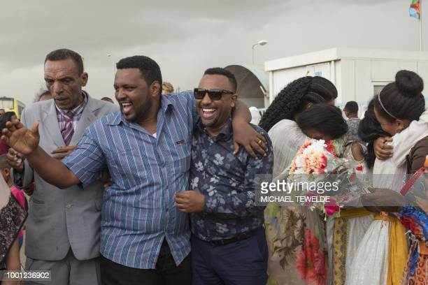 Longseparated families are reunited on the tarmac at the Asmara International airport on July 18 upon the arrival of the first flight from Ethiopian...