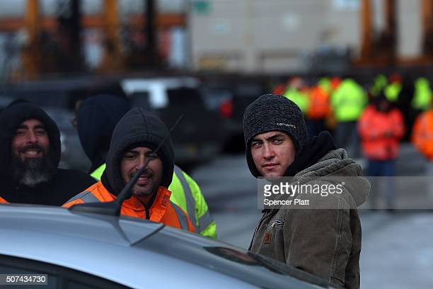 Longshoremen stand in an entrance at the Port of Newark after they walked off the job at the port terminals in New Jersey and Staten IslandFriday...