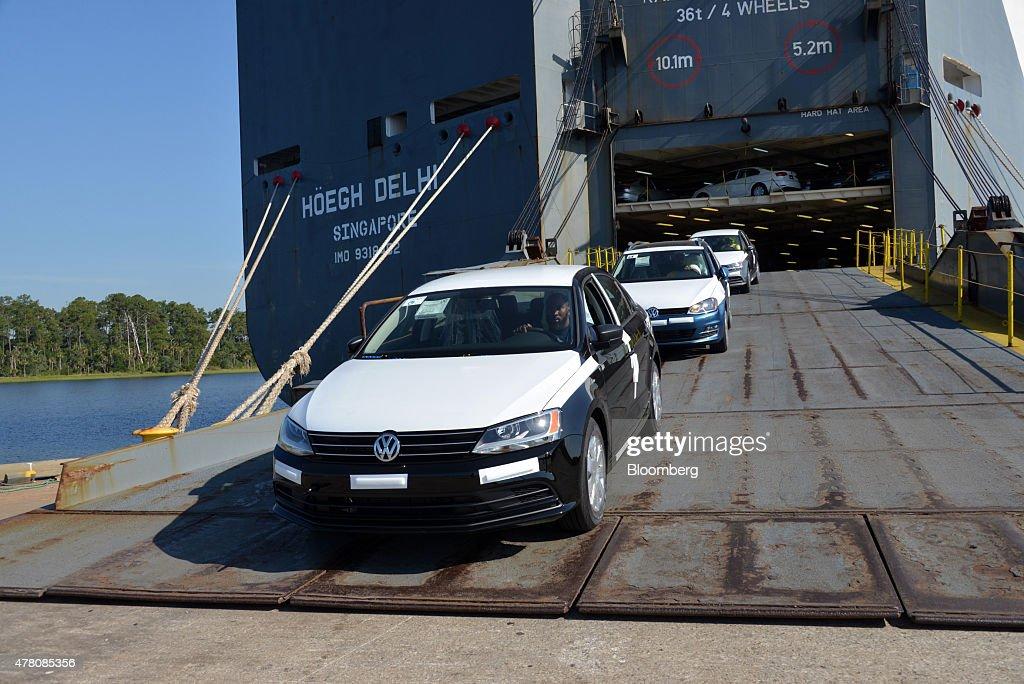 Longshoremen unload Volkswagen AG vehicles from the Hoegh