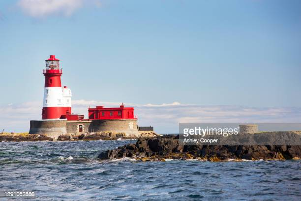longstone lighthouse on the farnes islands, off seahouses in northumberland, from where grace darling made her famous rescue of shipwreck survivors. - ashley grace stock pictures, royalty-free photos & images