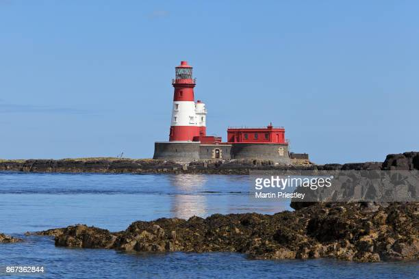 longstone lighthouse, situated on the farne islands off the coast of northumberland in northeast england - northumberland stock photos and pictures