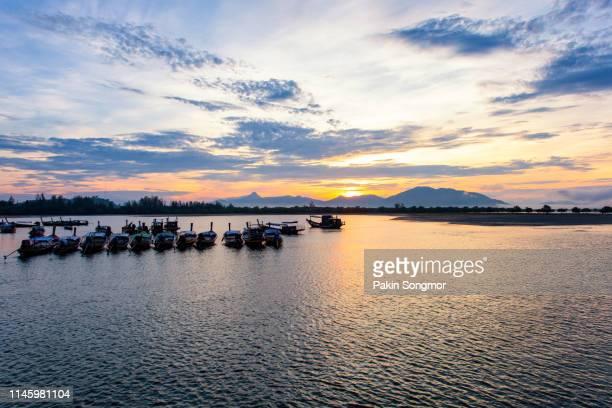 longtail boat at bang ben beach in sunrise time - インド洋 ストックフォトと画像