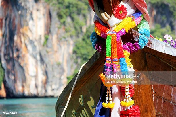 Long-Tail Boat Decorated With Garland