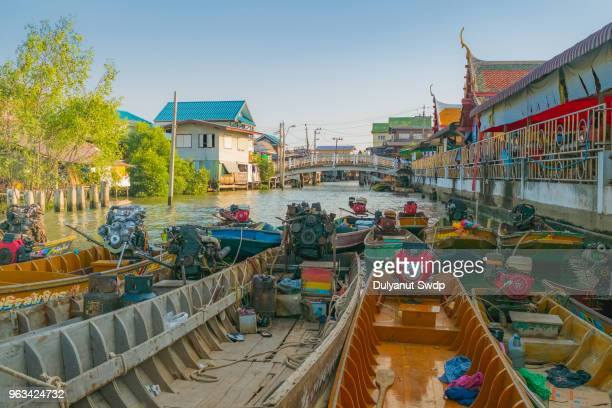 long-tail boat in canal, bangkok, thailand - floating market stock pictures, royalty-free photos & images