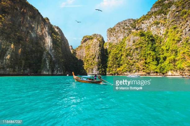 longtail boats in pileh lagoon, phi phi islands, thailand - indian ocean stock pictures, royalty-free photos & images