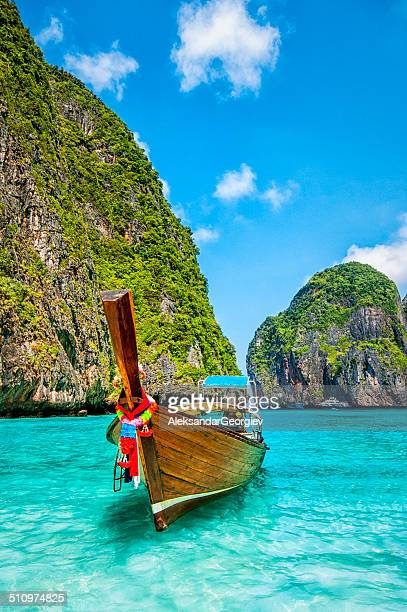 longtail wooden boat at maya bay, thailand - thailand stock pictures, royalty-free photos & images