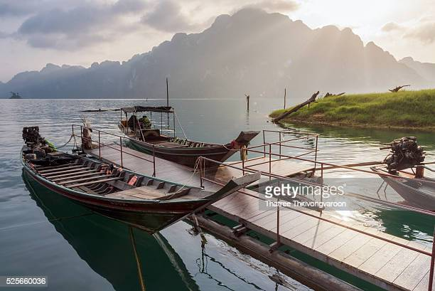 Long-tailed boat floating on green and clear water, Khao Sok National Park at Suratthani,Thailand