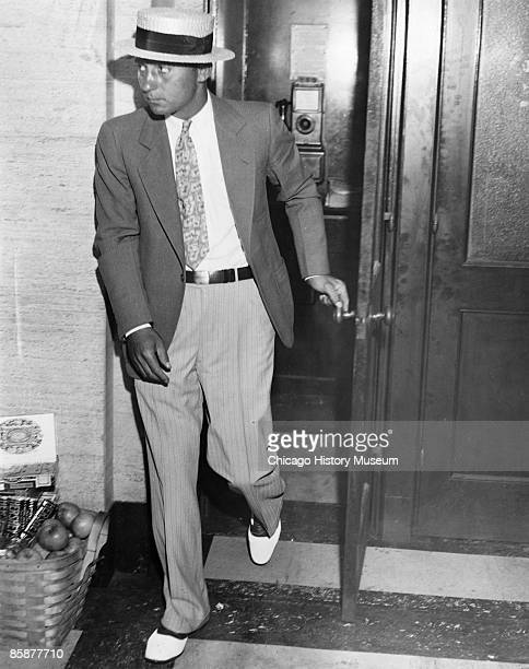Longtime Capone enforcer and bodyguard 'Machine Gun' Jack McGurn is seen leaving a phone booth at an unidentified location in Chicago ca1920s