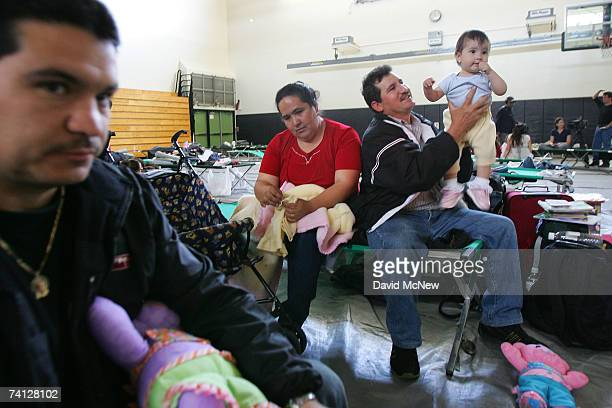 Longtime Catalina Island resident Jesus Silva entertains his 9monthold daughter Jareli as he passes his time with his wife Maria and Rugelio...