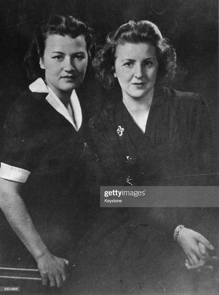Long-time companion of German dictator Adolf Hitler, Eva Braun (1912 – 1945, right) with her childhood friend Herta Schneider, circa 1940.