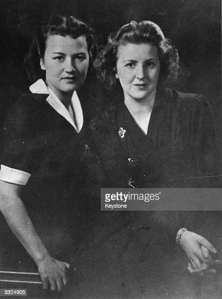 Long-time companion of German dictator Adolf Hitler, Eva Braun with her childhood friend Herta Schneider, circa 1940.
