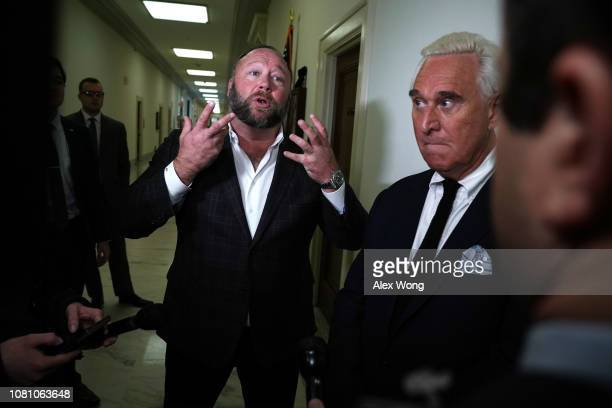 Longtime informal adviser to President Trump Roger Stone and Alex Jones of Infowars speak to cameras outside a hearing where Google CEO Sundar Pichai...