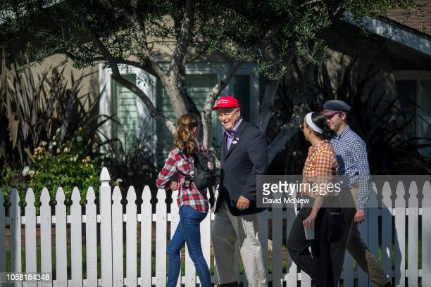 Longtime Rep. Dana Rohrabacher walks along the street with family members after dropping off his ballot at his polling place on November 6, 2018 in...