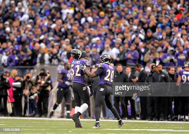 Longtime teammate Baltimore Ravens inside linebacker Ray Lewis and free safety Ed Reed walk off the field together for the last time late the second...